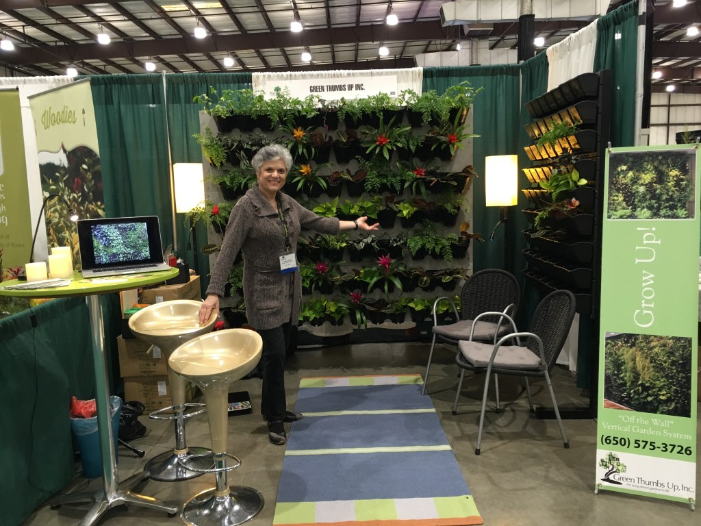 "Fanny Obadia, Owner of Green Thumbs Up Inc., Showing ""Off the Wall"" Vertical Garden Systems at the NorCal Plant Show in San Mateo CA (2016)"